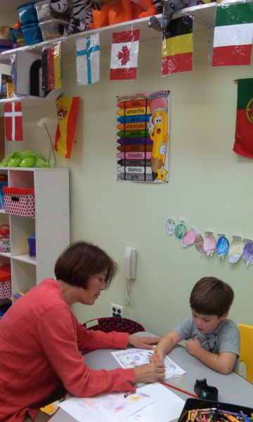 student and teacher in language classroom