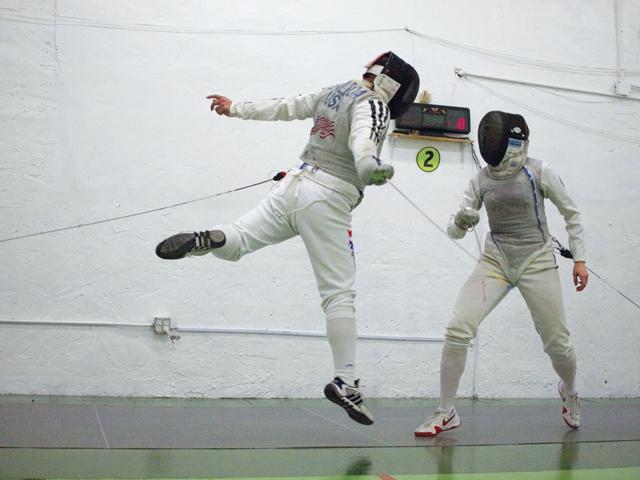Kids practice fencing