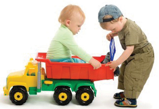 Boys Playing with Trucks