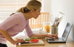 Woman searching online for a recipe