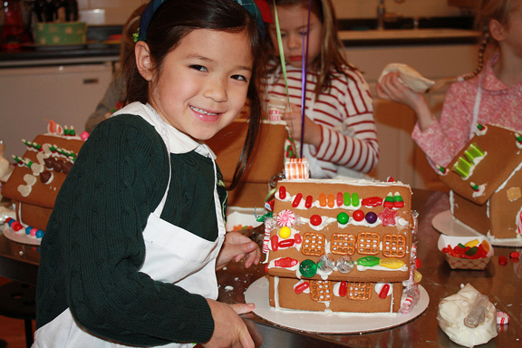 girl decorating gingerbreadhouse at Taste Buds Kitchen