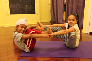 Little kids in a yoga pose