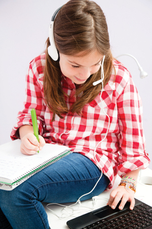 Girl studyng with headphones