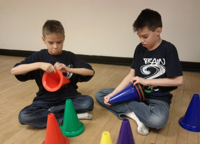 children setting up obsticle course