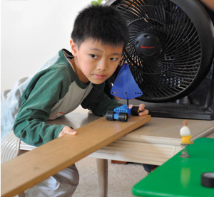 young boy creating a simple machine