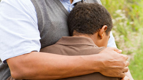 comforting child after school shooting