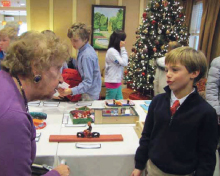 Portledge School Students Visit Atria Glen Cove Senior Center