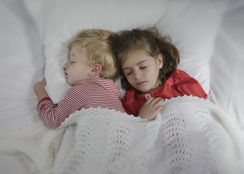 boy and girl toddlers sleeping