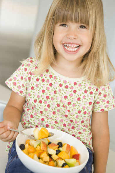 child eating fruit