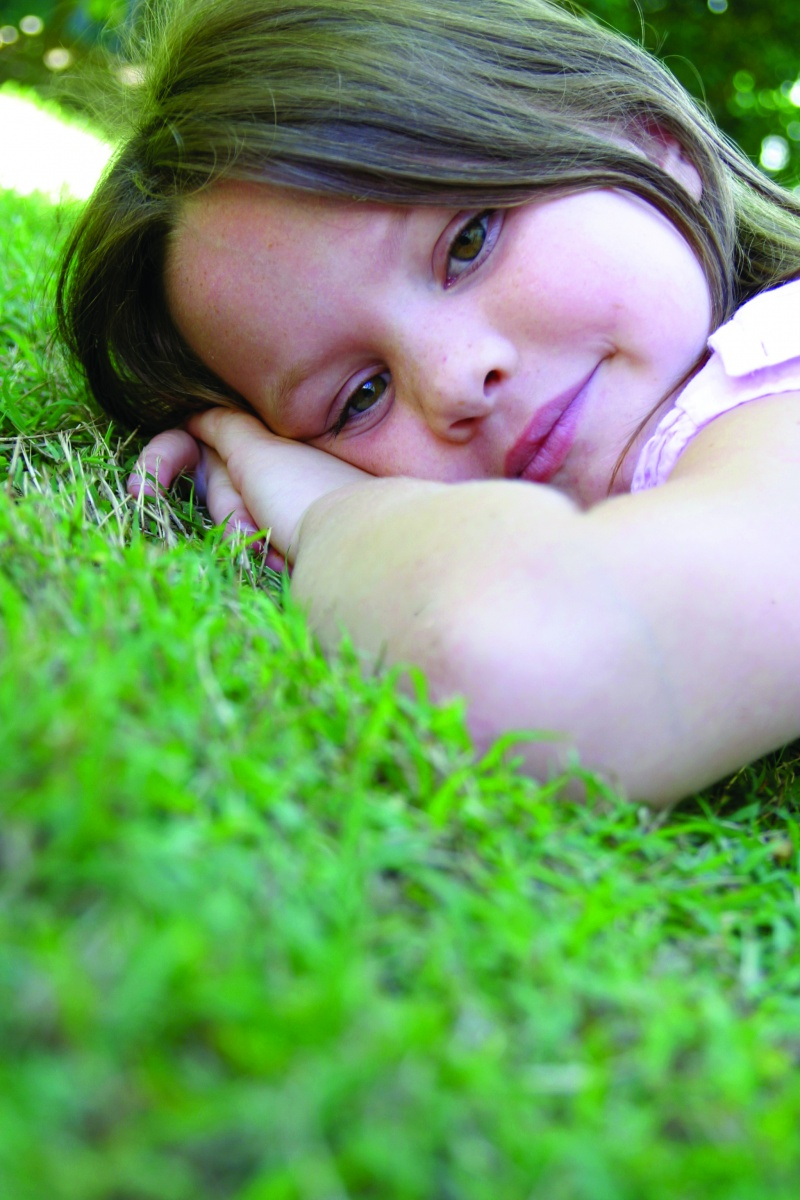 Young girl resting on the grass