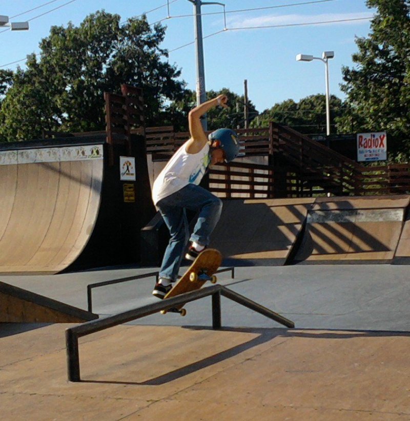 skateboarder on a rail