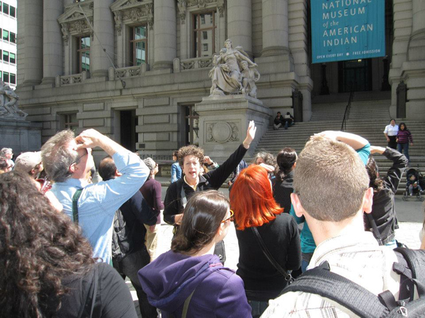 A group of tourists on a Wall Street Walk.