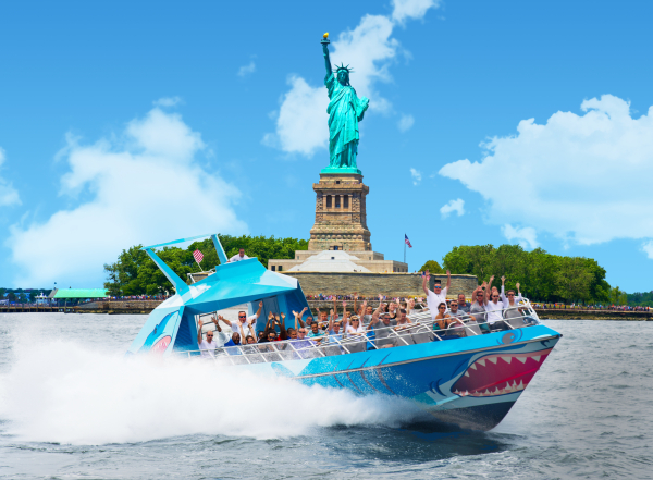 the shark speedboat statue liberty