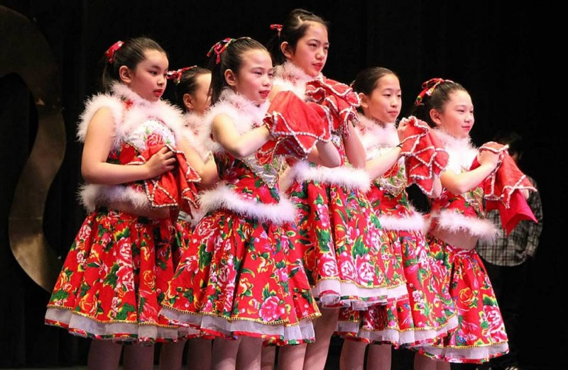 students perform a Chinese folk dance