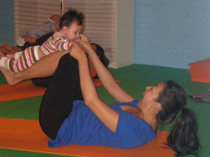 mom and baby airplane pilates pose