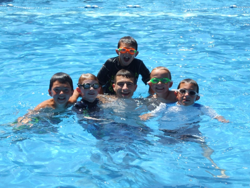 campers and counselor swimming