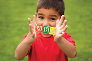 little boy with abc alphabet blocks