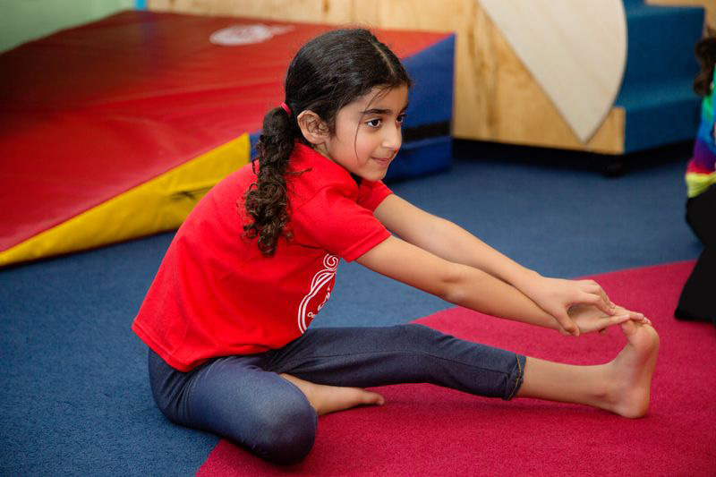 young girl gymnast stretching