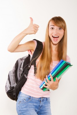 enthusiastic young girl with school supplies