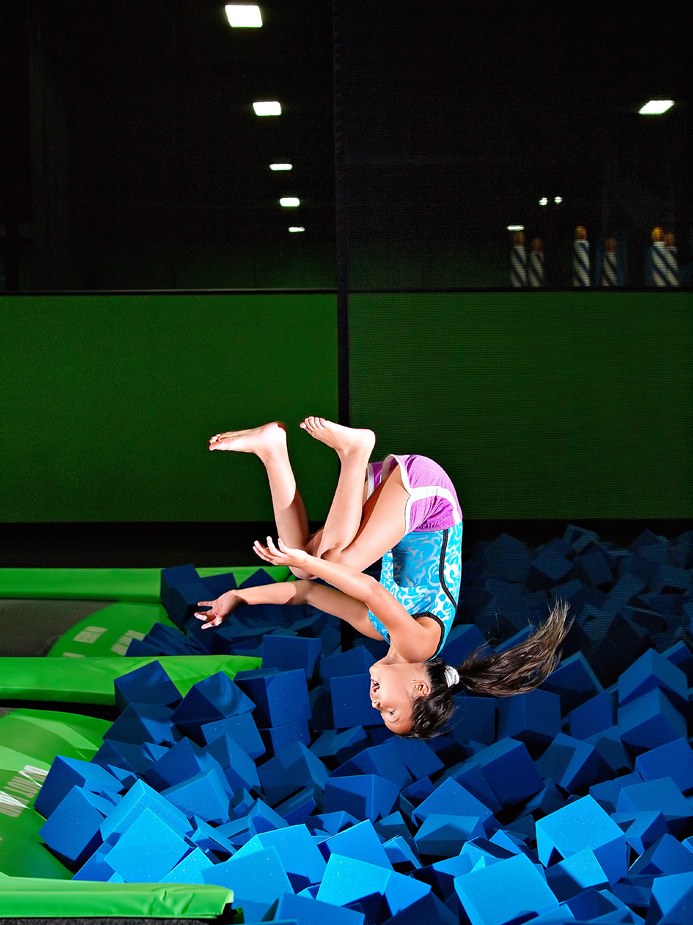 girl flipping into foam pit