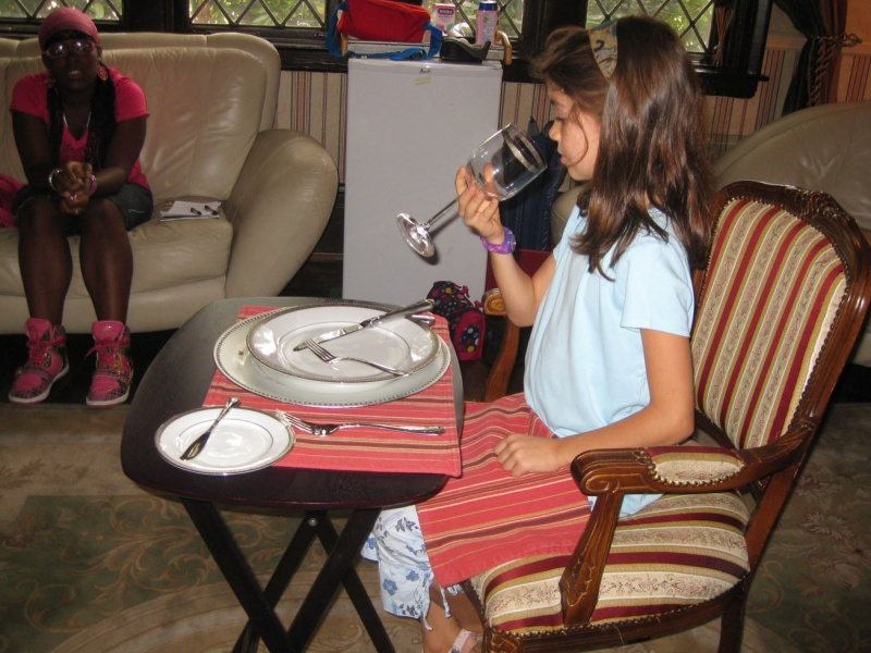 young girl learning dining room etiquette