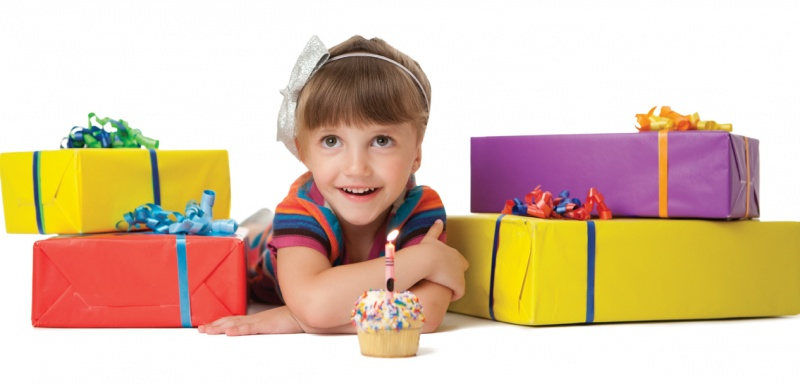 birthday girl with cupcake and presents