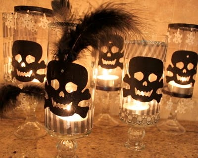 glass candle holders decorated for halloween