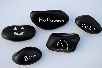 stones painted with chalkboard paint as halloween decorations