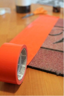 covering halloween doormat with tape