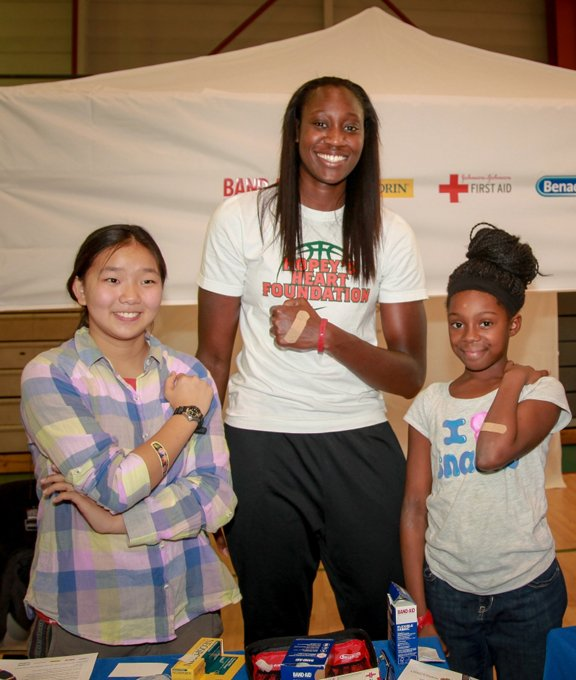 tina charles at sports safety clinic for kids in harlem