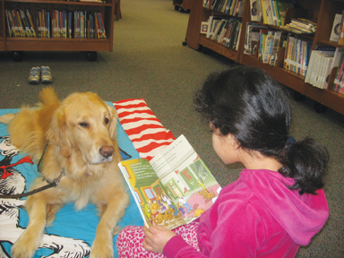 child reading to dog