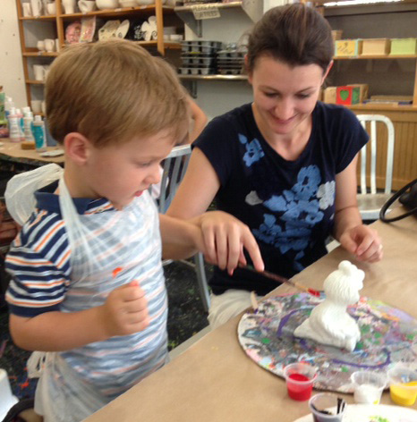 owner and son paint pottery