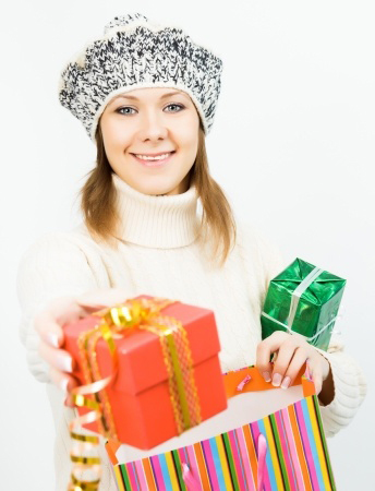 woman holding wrapped presents