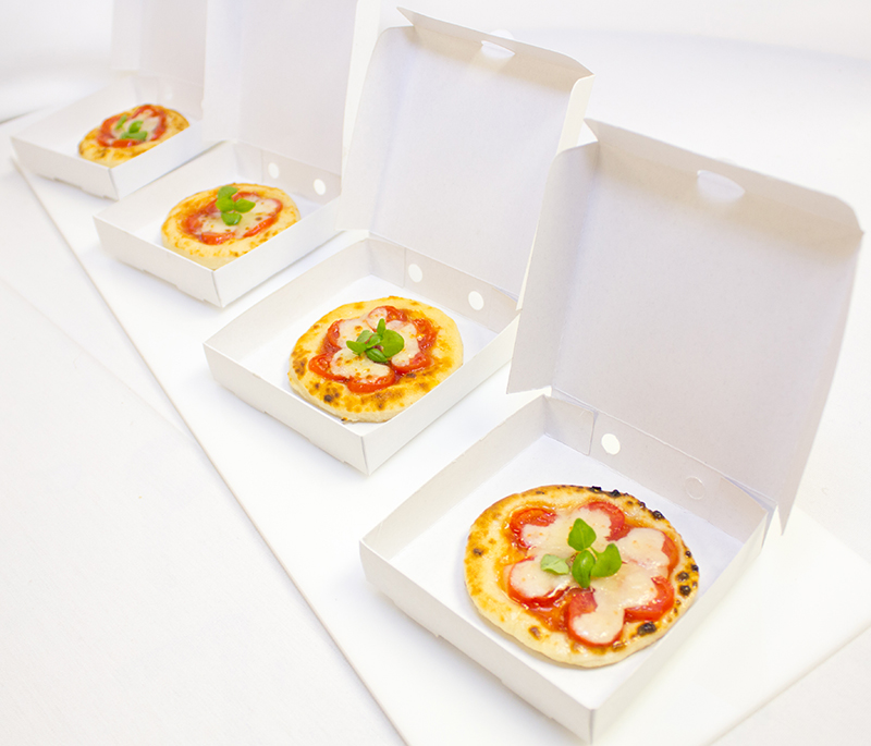 mini individual pizzas in boxes