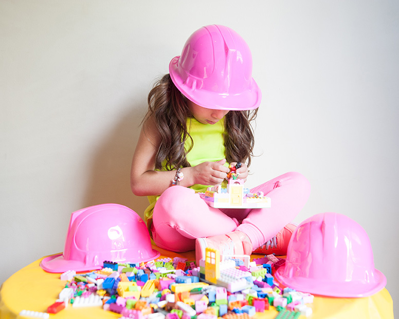 girl building with lego friends