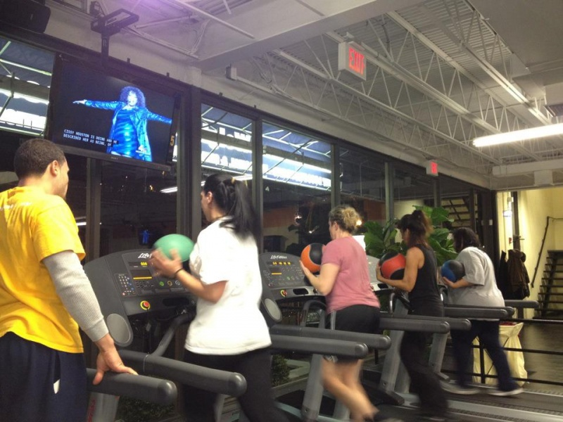 people working out on treadmills