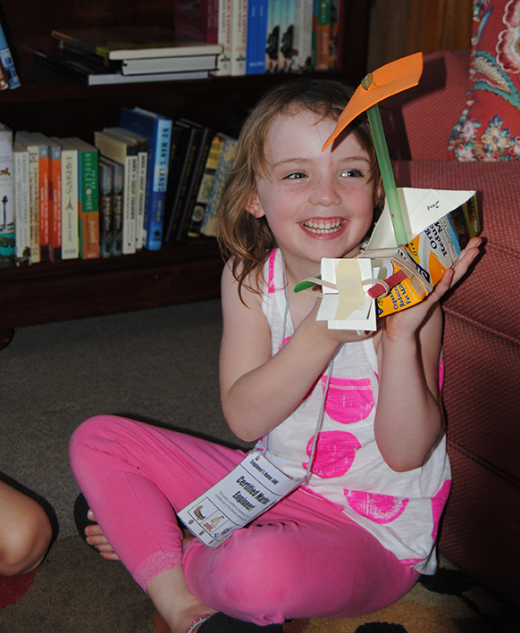 girl with recycled boat craft