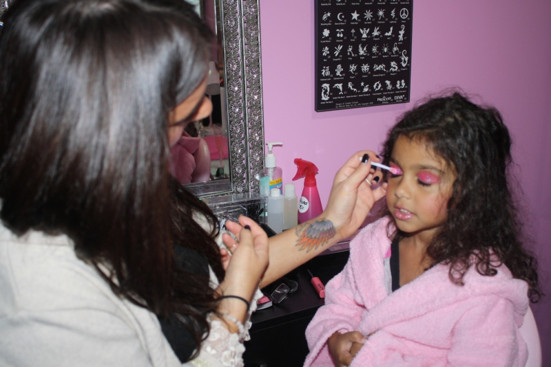 girl getting makeup applied