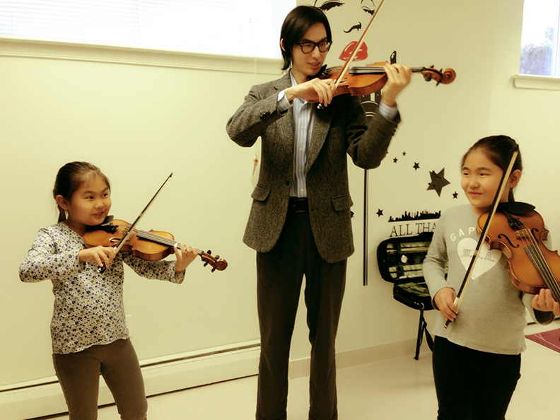 violin students with instructor
