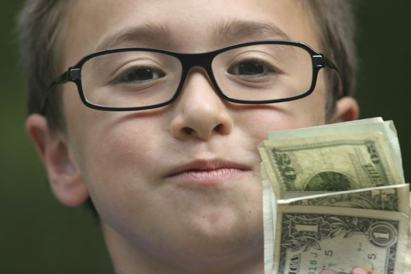 boy-holding-money