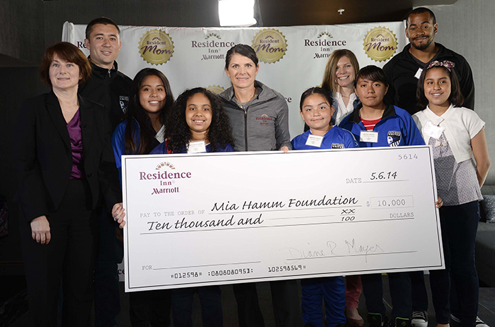 mia hamm with check from residence inn