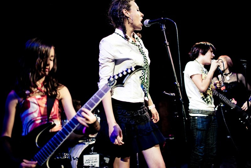 teen rock band performing