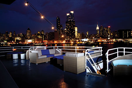 The stunning view of the Manhattan skyline at night from aboard World Yacht