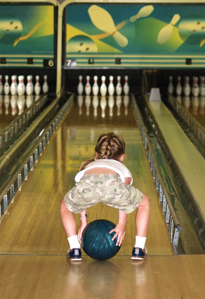 young girl bowling