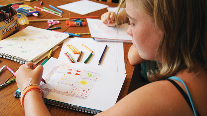 girl drawing garden map