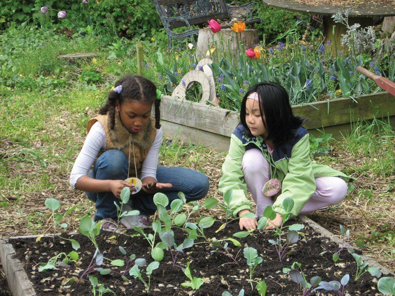 two girls gardening at queens botanical garden