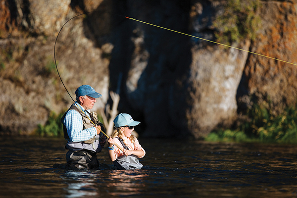 grandfather and granddaughter fly fishing