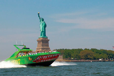 Circle Line 42's The Beast Speedboat rushes past the Statue of Liberty