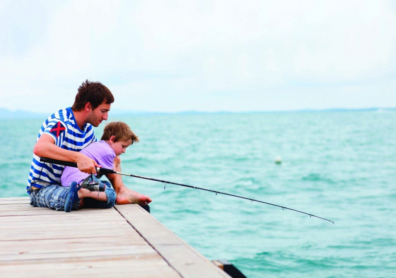 dad and son on fishing dock