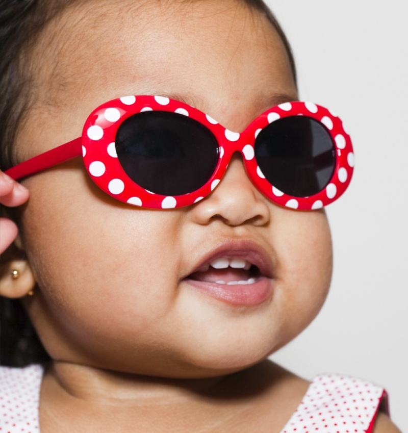 baby wearing red sunglasses